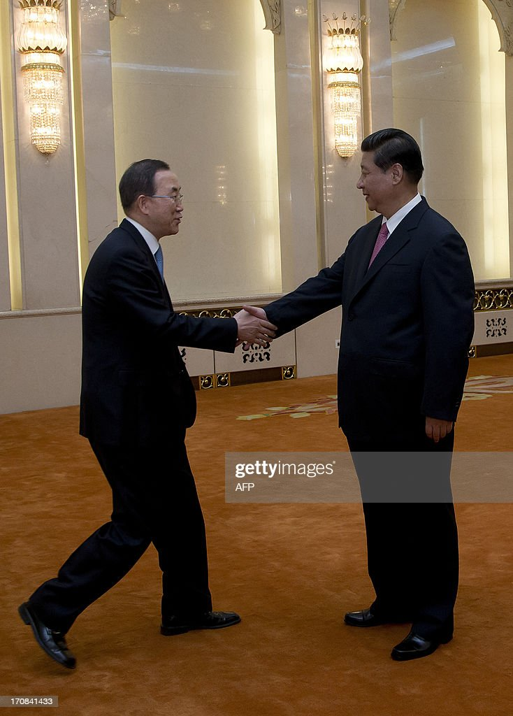 United Nations Secretary-General Ban Ki-moon (L) shakes hands with Chinese president Xi Jinping upon his arrival for a meeting at the Great Hall of the People in Beijing on June 19, 2013. United Nations Secretary-General Ban Ki-moon met Chinese president Xi Jinping for talks on June 19, with North Korea and Syria expected to dominate discussions.