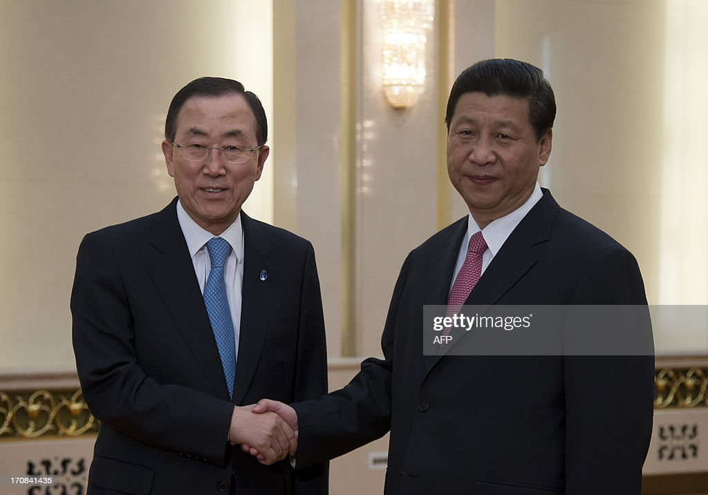United Nations Secretary-General Ban Ki-moon (L) shakes hands with Chinese president Xi Jinping before a meeting at the Great Hall of the People in Beijing on June 19, 2013. United Nations Secretary-General Ban Ki-moon met Chinese president Xi Jinping for talks on June 19, with North Korea and Syria expected to dominate discussions.
