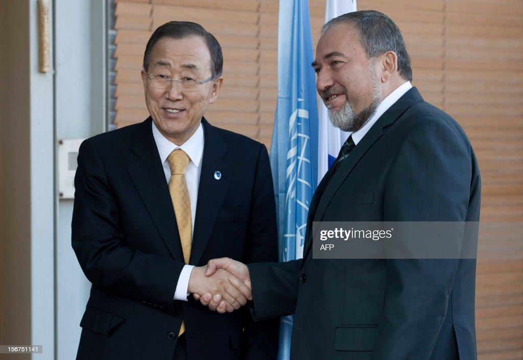 United Nations Secretary-General Ban Ki-moon (L) shakes hands with Israeli Minister of Foreign Affairs Avigdor Lieberman in Jerusalem on November 20, 2012. Ban urged both Israel and Gaza militants to stop their fire 'immediately' as he held talks in Cairo aimed at securing a deal between the Jewish state and Gaza's Islamist Hamas rulers. AFP PHOTO / POOL / MIHAL FATTAL