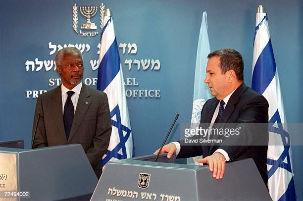 United Nations SecretaryGeneral Koffi Annan left listens as Israeli Prime Minister Ehud Barak addresses a press conference after their meeting to...