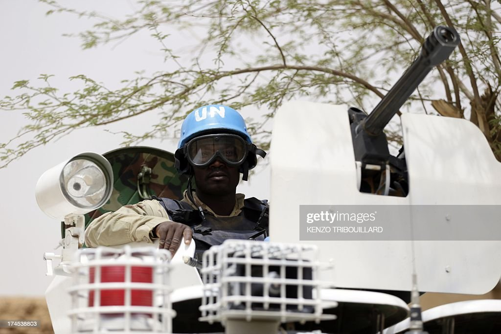 United Nations soldiers patrol on July 27 2013 in the northern Malian city of Kidal Clashes between Tuaregs and black Africans a week ago left four...