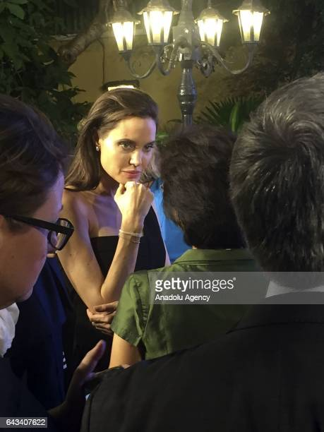 United Nations Special Envoy for Refugees and American actress Angelina Jolie speaks with guests after her speech on sexual violence in conflict at...