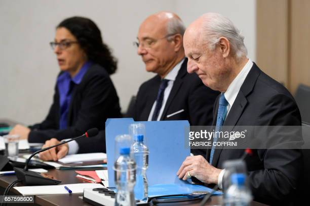 United Nations Special Envoy for Syria Staffan de Mistura and Deputy UN Special Envoy for Syria Ramzy Ezzeldin Ramzy seat at the opening of a meeting...