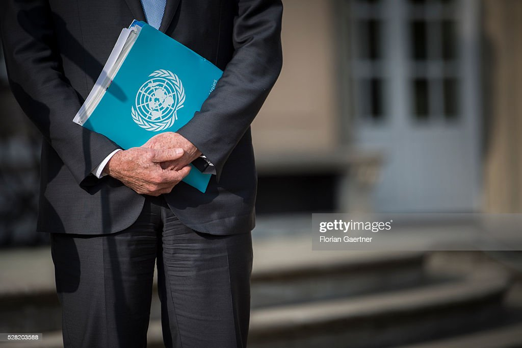 United Nations Special Envoy for Syria Staffan de Mistura holds a folder with the UN logo on May 04, 2016 in Berlin, Germany. The meeting was held to discuss Syria as concerns grow over the faltering ceasefire in the war-torn country.