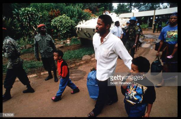 United Nations troops evacuate two hundred forty Tutsis from the Mille Collines Hotel May 25 1994 in Kigali Rwanda Following the assassination of...