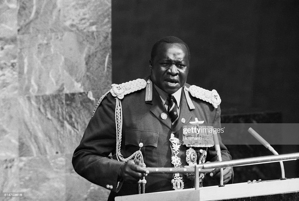 Uganda Pres. Idi Amin, resplendent is a blue, red and gold field marshal's uniform, addresses U.N. General Assembly following his introduction here 10/1. The massive East African leader is holding a field marshall's baton. Amin, who spoke 100 words in Swahili during his introductory speech, had his official speech read in English by Uganda U.N. Ambassador Khalid Younis Kiene. Amin apparently only speaks Swahili. 10/2/1975