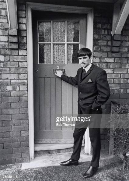 Sport Football England Circa 1964/5 Manchester United Northern Ireland footballer George Best stands outside the doorway of Mrs Mary Fullaway his...