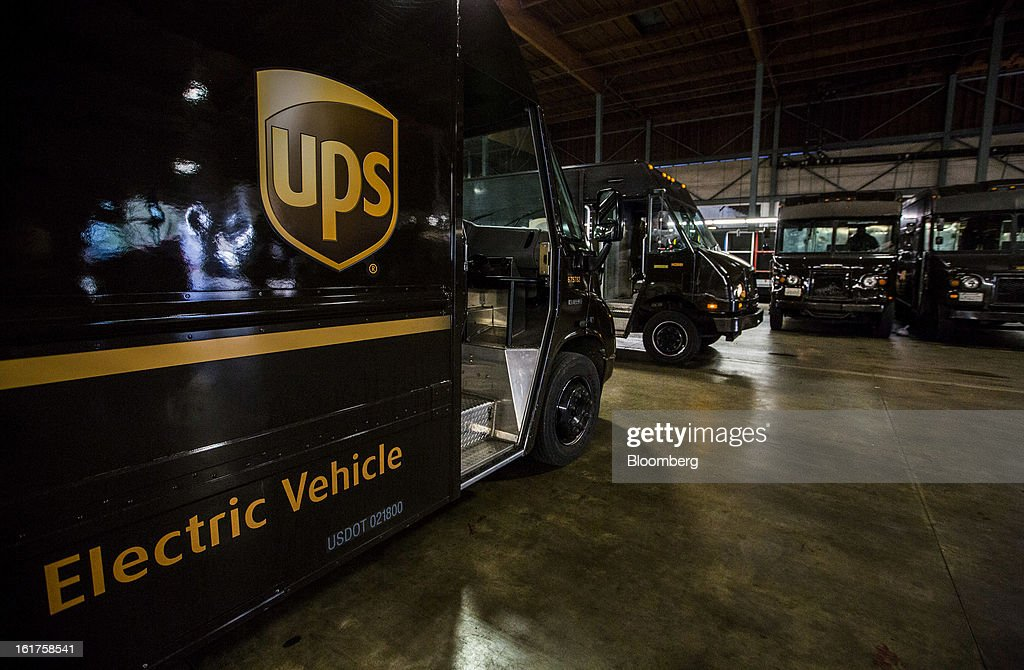 United Parcel Service (UPS) delivery trucks prepare to depart from the distribution center in Sacramento, California, U.S., on Thursday, Feb. 14, 2013. 100 UPS delivery all-electric vehicles, developed by Electric Vehicles International (EVI), have been deployed this week and are said to eliminate the use of 126,000 gallons of fuel per year. Photographer: Ken James/Bloomberg via Getty Images