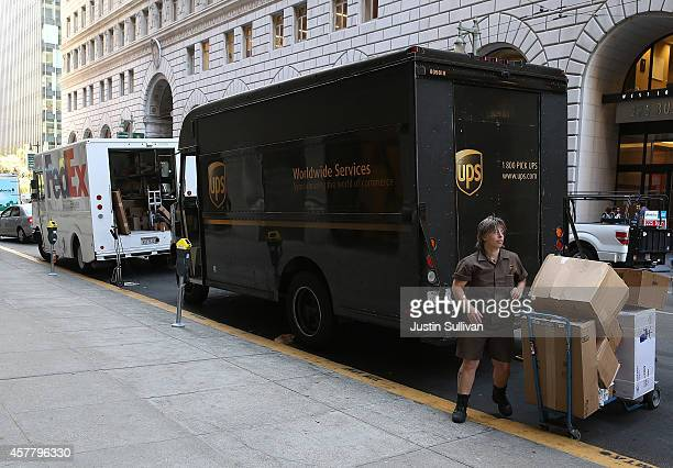 United Parcel Service driver unloads packages from her truck on October 24 2014 in San Francisco California United Parcel Service reported quarterly...