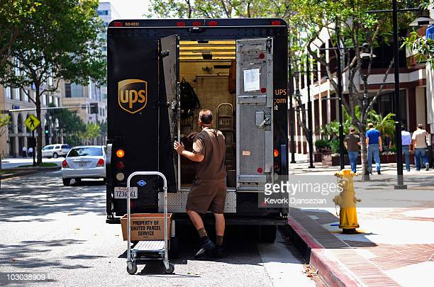 United Parcel Service driver walks back to his truck after making a delivery on July 22 2010 in Glendale California UPS said its second quarter...