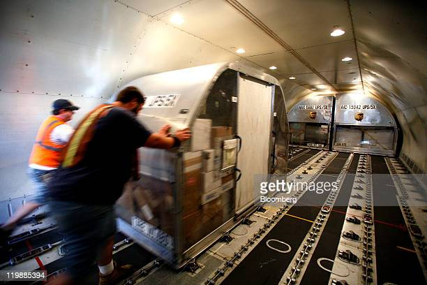 United Parcel Service Inc cargo loaders load air containers onto a UPS Boeing 767 jet at the UPS air hub at Mather Airport in Sacramento California...