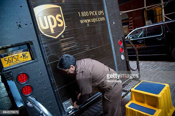 A United Parcel Service Inc driver locks a truck in New York US on Friday Oct 23 2015 UPS is scheduled to release thirdquarter earnings results on...