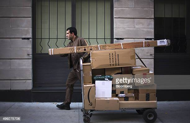A United Parcel Service Inc driver pushes a dolly of packages for delivery on Cyber Monday in New York US on Monday Nov 30 2015 Online sales on Cyber...