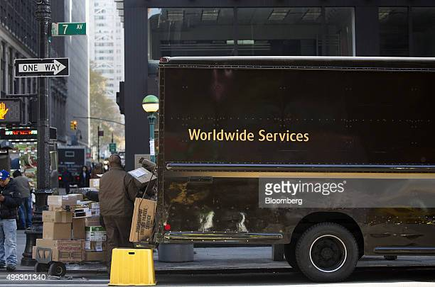 A United Parcel Service Inc driver stacks packages onto a dolly for delivery on Cyber Monday in New York US on Monday Nov 30 2015 Online sales on...