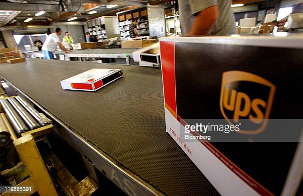 United Parcel Service Inc packages travel down a conveyor belt in the sort area at the UPS air hub at Mather Airport in Sacramento California US on...
