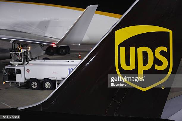 United Parcel Service Inc signage is displayed on the tail section of a cargo jet on the tarmac at the UPS Worldport facility in Louisville Kentucky...