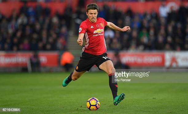 United player Michael Carrick in action during the Premier League match between Swansea City and Manchester United at Liberty Stadium on November 6...