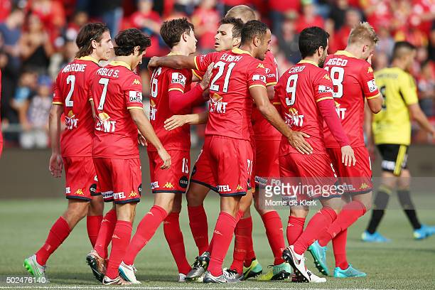 United players celebrate a goal by Craig Goodwin during the round 12 ALeague match between Adelaide United and the Wellington Phoenix at Coopers...