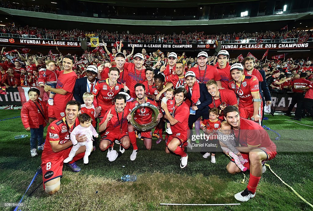 United players pose for a photo in front of their supporters after the 2015/16 A-League Grand Final match between Adelaide United and the Western Sydney Wanderers at Adelaide Oval on May 1, 2016 in Adelaide, Australia.