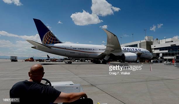 United ramp agent Jeff Larimer admires a Boeing 787 Dreamliner preparing for departure at Denver International Airport in Denver CO May 21 2013 It is...