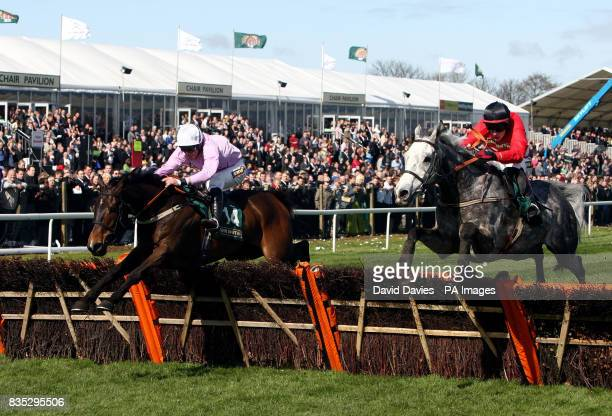 United ridden by Dominic Elsworth leads Fiveforthree ridden by Paul Townsend to go on and win the John Smith's Aintree Hurdle race during the third...