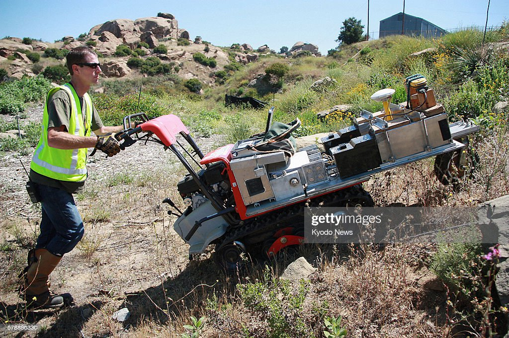 VALLEY United States A contractor of the Environmental Protection Agency uses gammascanning equipment mounted on an allterrain cart and connected to...