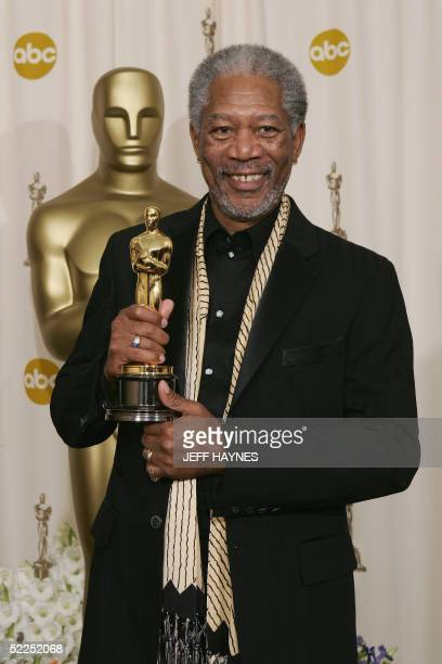 Actor Morgan Freeman nominated for Best Supporting Actor for his role in 'Million Dollar Baby' poses with his trophy at the Kodak Theater in...