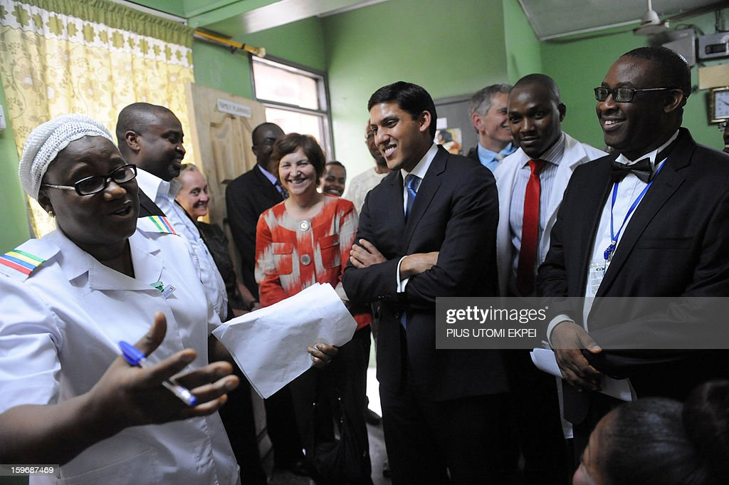 United States Agency for International Development (USAID) Adminstrator Rajiv Shah (C) and Medical Director of Lagos Island Maternity Hospital Imosemi Donald (R) smile as chief matron Bolanle Bello (L) relates the achievements of the family planning unit of the hospital during an inspection of health facilities sponsored by the agency in Lagos January 18, 2013. Shah is in Nigeria to meet with senior government officials to further USAID's collaboration with the government. He will also meet with leaders in private sector to discuss new opportunities for partnerships that can accelerate growth and development.