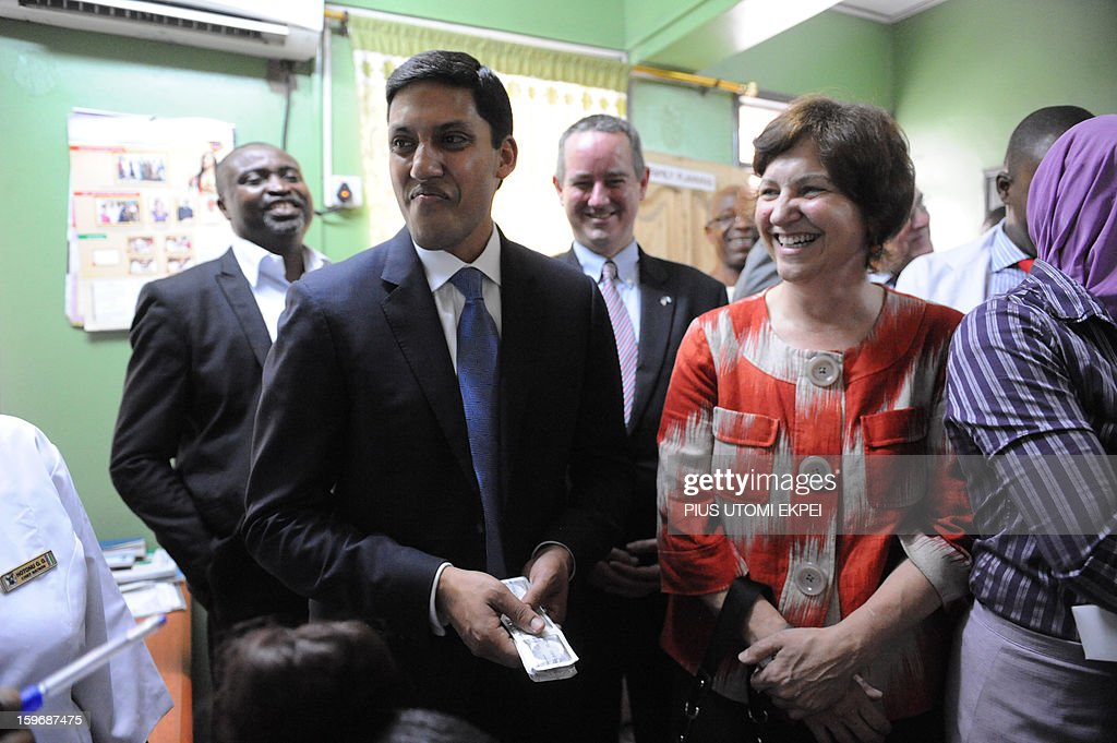 United States Agency for International Development (USAID) Adminstrator Rajiv Shah (L) holds sachets of Condom presented to him as a rule at the family planning unit of Lagos Island Maternity Hospital during an inspection of health facilities sponsored by the agency in Lagos January 18, 2013. Shah is in Nigeria to meet with senior government officials to further USAID's collaboration with the government. He will also meet with leaders in private sector to discuss new opportunities for partnerships that can accelerate growth and development.