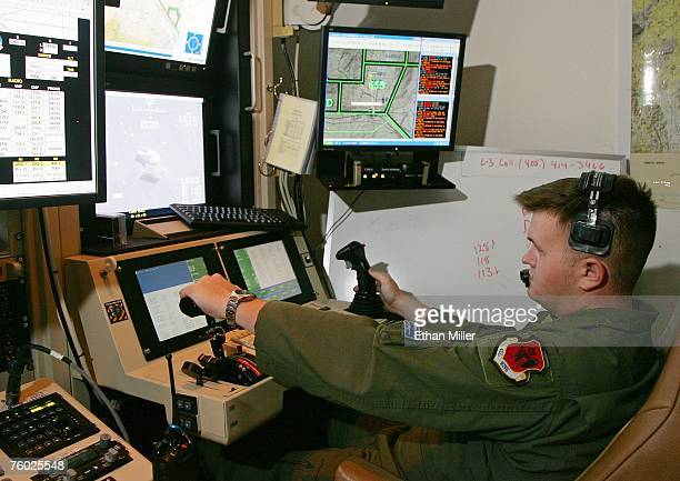 United States Air Force Senior Airman William Swain operates a sensor control station for an MQ9 Reaper during a training mission August 8 2007 at...