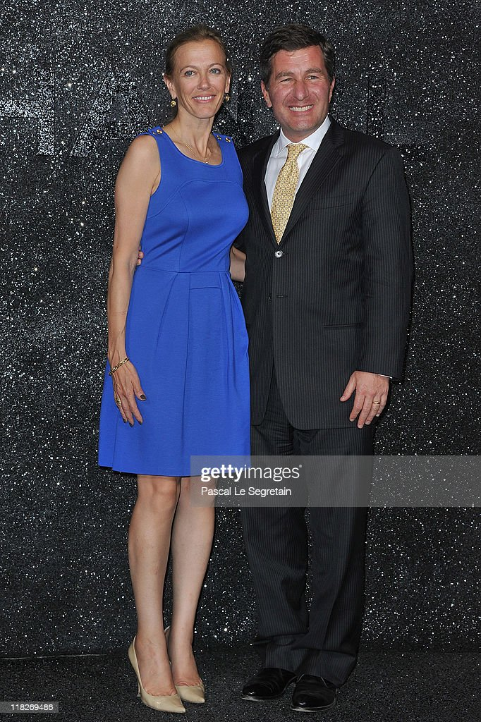 United States Ambassador to France and Monaco Charles H. Rivkin and his Wife Susan M. Tolson attend the Chanel Haute Couture Fall/Winter 2011/2012 show as part of Paris Fashion Week at Grand Palais on July 5, 2011 in Paris, France.