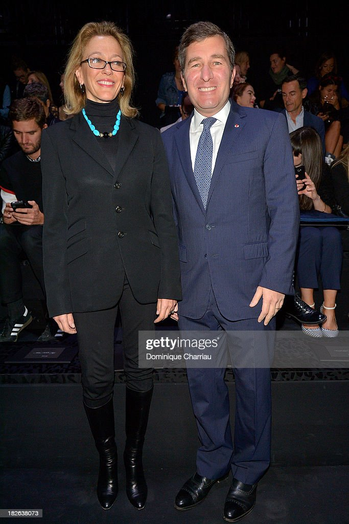 United States Ambassador to France <a gi-track='captionPersonalityLinkClicked' href=/galleries/search?phrase=Charles+Rivkin&family=editorial&specificpeople=4891546 ng-click='$event.stopPropagation()'>Charles Rivkin</a> and wife attend the Louis Vuitton show as part of the Paris Fashion Week Womenswear Spring/Summer 2014 on October 2, 2013 in Paris, France.