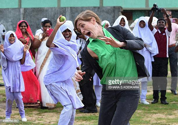 United States Ambassador to the United Nations Samantha Power plays the Sri Lankan bat and ball game called Elle with Muslim girls at the Osmaniay...