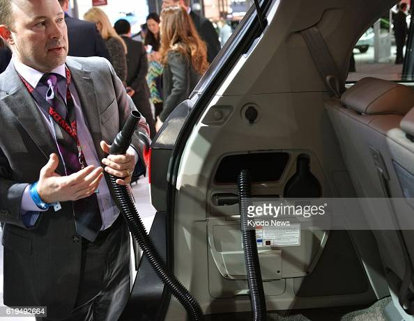 NEW YORK United States An official of Honda Motor Co speaks about a vacuum cleaner installed in a model of its Odyssey minivan at the annual New York...