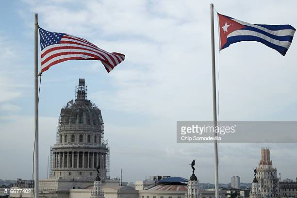 United States and Cuban flags fly sidebyside on the roof of the Iberostar Hotel Parque Central near El Capitolio in the historic Old Havana...