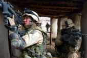 United States Army 10th Mountain soldiers take over a dwelling March 8 2002 near the villages of Sherkhankheyl Marzak and Bobelkiel Afghanistan The...
