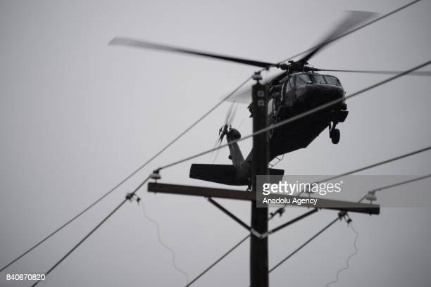 United States Army helicopter arrives at the MCHD EMS Station 30 heliport during hurricane Harvey in Humble TX United States on August 29 2017
