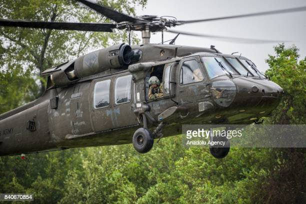 United States Army helicopter lands at the MCHD EMS Station 30 heliport during hurricane Harvey in Humble TX United States on August 29 2017