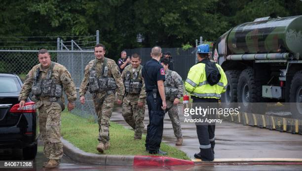 United States Army helicopter pilots take a break while their helicopter is getting refueled during hurricane Harvey in Humble TX United States on...