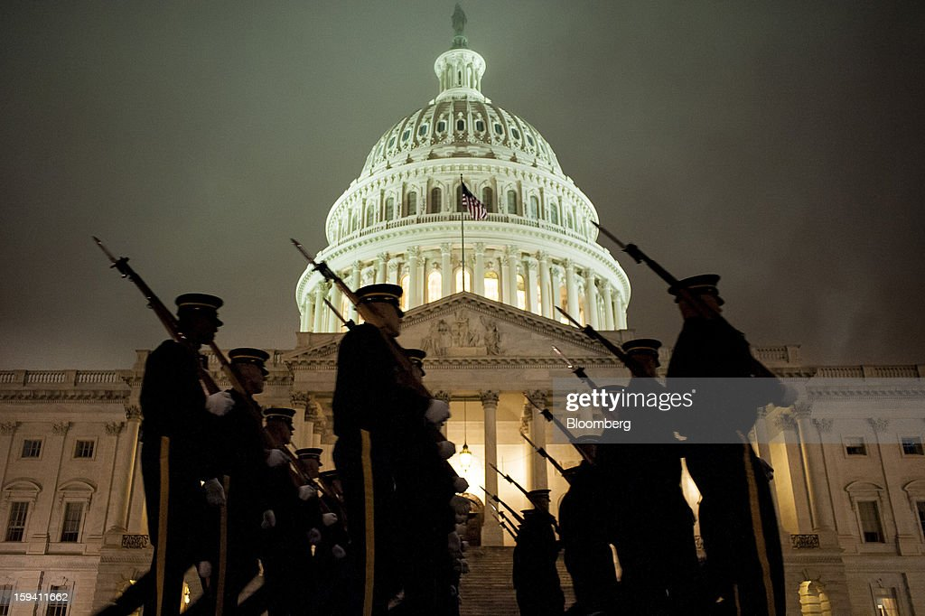 A United States Army Honor Guard rehearses for the 2013 presidential inaugural ceremonies in front of the East Front of the U.S. Capitol in Washington, D.C., U.S., on Sunday, Jan. 13, 2013. U.S. President Barack Obama will take the oath of office for another four-year term on Monday, Jan. 21, 2013. Photographer: Pete Marovich/Bloomberg via Getty Images