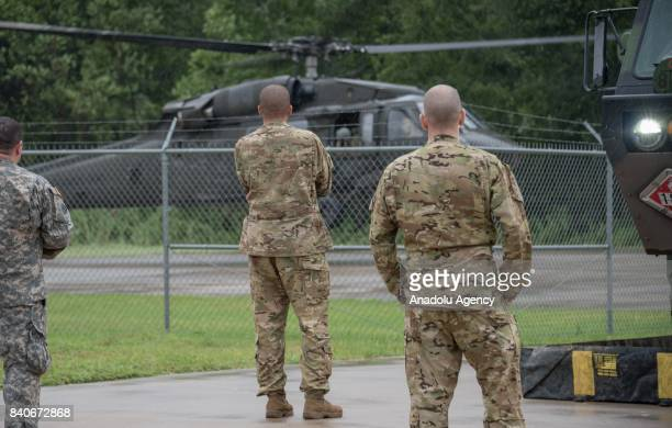 United States Army soldier await until their helicopter touches down at the MCHD EMS Station 30 heliport during hurricane Harvey in Humble TX United...
