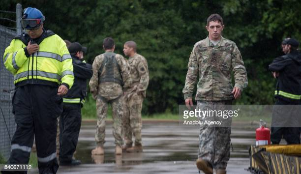 United States Army soldier prepare to refuel their just arrived helicopter during hurricane Harvey in Humble TX United States on August 29 2017