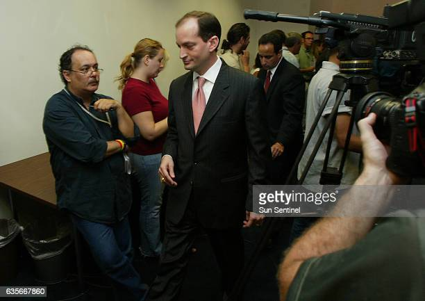 United States Attorney for the Southern District of Florida Alexander Acosta leaves the room after speaking with the media during a press conference...
