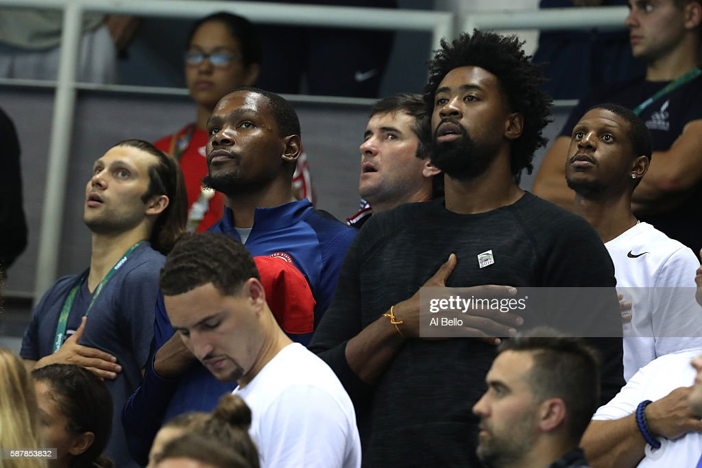 United States basketball players Kevin Durant Klay Thompson and DeAndre Jordan sing the American national anthen during the medal ceremony for the...