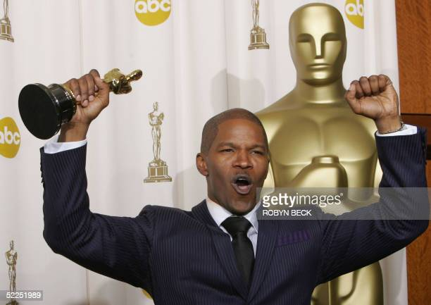 Best Actor Jamie Foxx pumps his fists hoisting his trophy at the Kodak Theater in Hollywood California 27 February during the 77th Academy Awards...