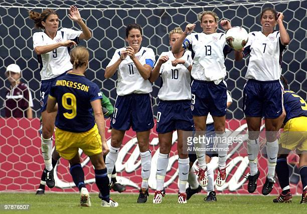 United States block a shot by Sweden midfielder Malin Andersson Sunday September 21 2003 at RFK Stadium Washington D C The U S defeated Sweden 3 1 in...