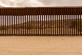 View of Mexico through international border wall at Jacumba California