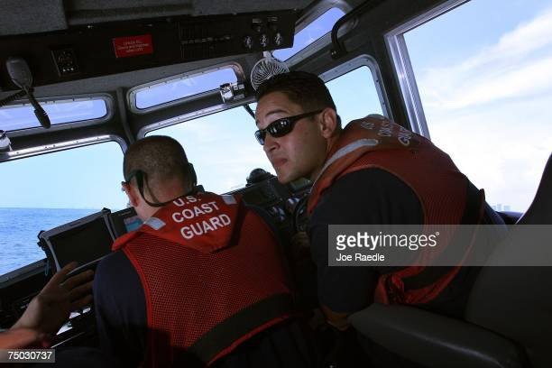 United States Coast Guard officer Michael Rivera patrols in the water off of Port Everglades July 4 2007 in Fort Lauderdale Florida Across the nation...