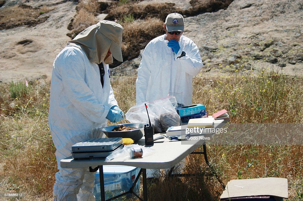 VALLEY United States Contractors of the Environmental Protection Agency collect soil samples at the former site of Santa Susana Field Laboratory in...