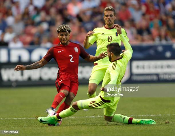 United States defender DeAndre Yedlin has the ball poked away by Venezuela's defender Rubert Quijada during the first half of an international...